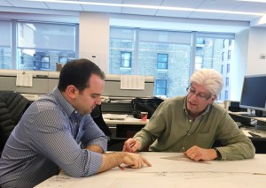 Mike Reilly (left) works with Ralph McCormick to review engineering diagrams.