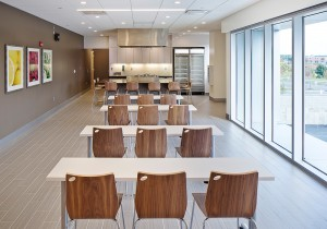Providing amenities such as cooking classes in a demonstration kitchen supports the pavilion's purpose as a place for both health and wellness.